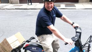 Colonial Systems installation foreman riding a Bluebike